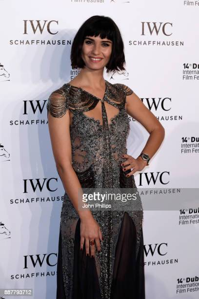 Tuba Buyukustun attends the sixth IWC Filmmaker Award gala dinner at the 14th Dubai International Film Festival during which Swiss luxury watch...