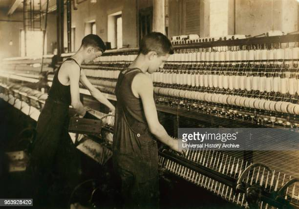 Tube Boy 14 years old Doffer Boy 16 years old Mule Spinning Room at Textile Mill Fall River Massachusetts USA Lewis Hine for National Child Labor...