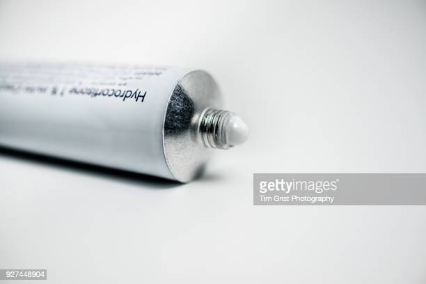 a tube of hydrocortisone cream - eczema stock pictures, royalty-free photos & images
