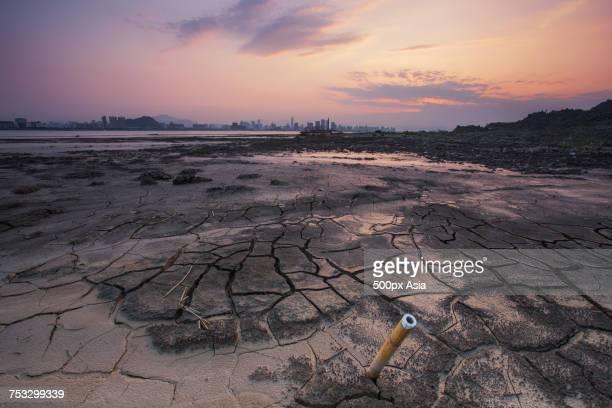 Tube sticking out of cracked soil at dusk, Wenzhou, Zhejiang, China