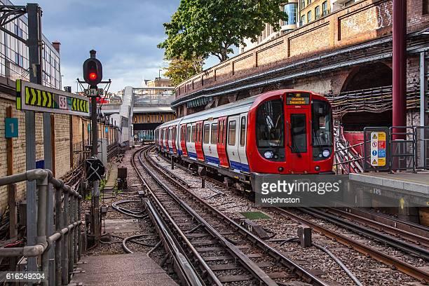Tube Train Arrives at Farringdon Station