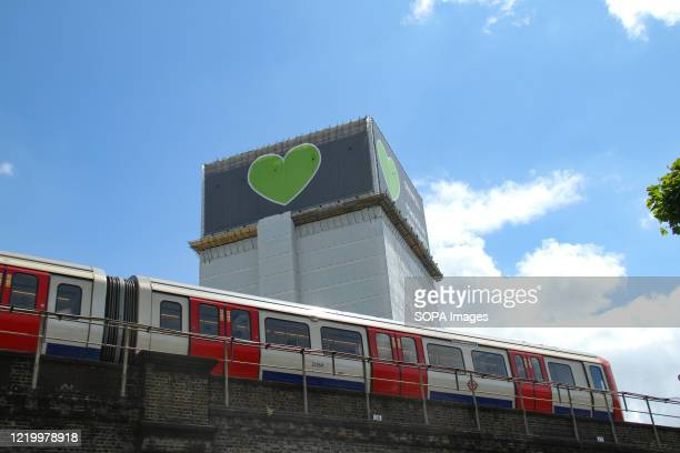 A tube train seen below the 24 story shell of the Grenfell tower during the 3rd anniversary Seventytwo people were killed in the blaze that burnt the...