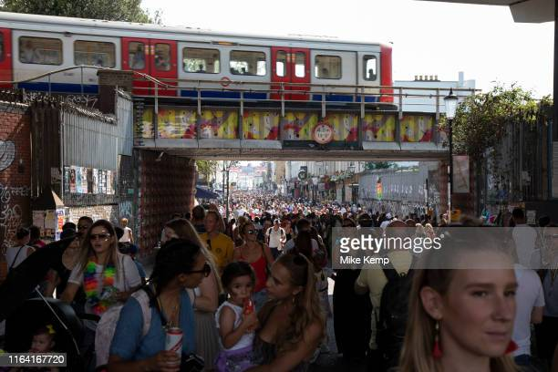 Tube travels over Portobello Road as crowds gather in Notting Hill Carnival on 25th August 2019 in West London United Kingdom A celebration of West...