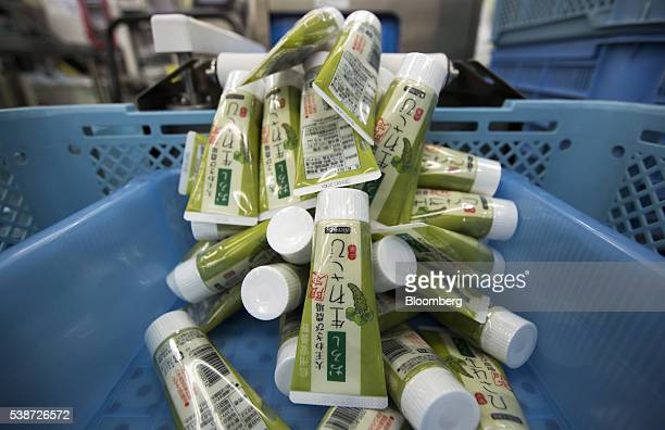 Tubes of Daio Wasabi Farm branded wasabi paste fall from a conveyor into a basket on the production line of the Marui Co. Factory in Azumino, Nagano...