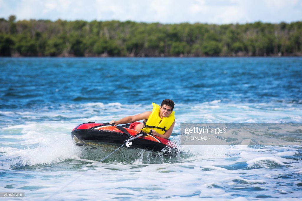 Tubing behind boat : Stock Photo