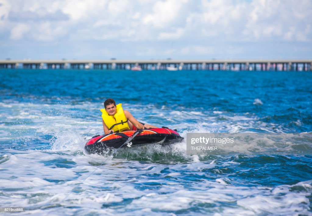 Tubing behind boat : Stock Photo
