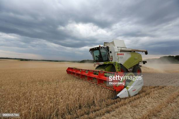 A Tucano combine harvester manufactured by Claas KGaA drives through a field of wheat during the summer harvest on a farm operated by Ros Agro Plc in...
