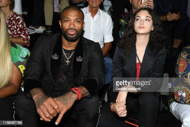 J Tucker and Deva Cassel attend Dolce Gabbana Front Row Milan Men's Fashion Week Spring/Summer 2020 on June 15 2019 in Milan Italy