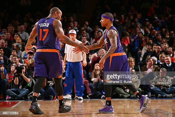 J Tucker and Isaiah Thomas of the Phoenix Suns celebrate during the game against the New York Knicks on December 20 2014 at Madison Square Garden in...