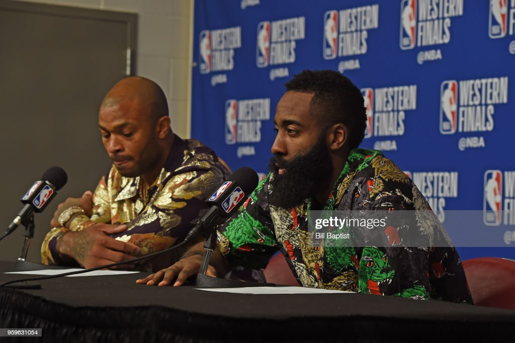 PJ Tucker #4 and James Harden #13 of the Houston Rockets speak with the media after the game against the Golden State Warriors in Game Two of the Western Conference Finals of the 2018 NBA Playoffs on May 16, 2018 at the Toyota Center in Houston, Texas.
