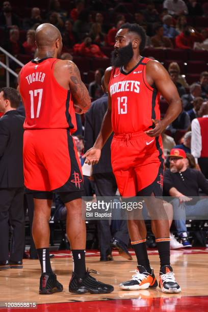 J Tucker and James Harden of the Houston Rockets talk during the game against the Memphis Grizzlies on February 26 2020 at the Toyota Center in...