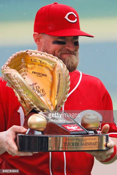 Tucker Barnhart of the Cincinnati Reds accepts his Gold Glove award prior to the game against the St Louis Cardinals at Great American Ball Park on...