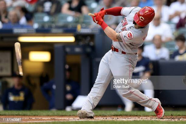 Tucker Barnhart of the Cincinnati Reds breaks his bat hitting a foul ball in the first inning against the Milwaukee Brewers at Miller Park on June 20...