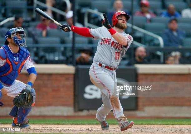 Tucker Barnhart of the Cincinnati Reds follows through on a ninthinning threerun home run against the New York Mets at Citi Field on September 10...