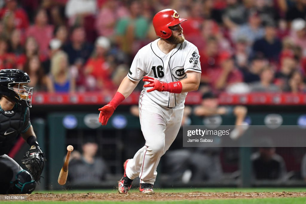 Tucker Barnhart #16 of the Cincinnati Reds hits a double in the seventh inning against the Arizona Diamondbacks at Great American Ball Park on August 10, 2018 in Cincinnati, Ohio. Cincinnati defeated Arizona 3-0.