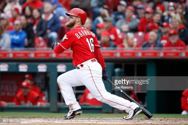 Tucker Barnhart of the Cincinnati Reds hits a double to center in the sixth inning of the game against the Chicago Cubs at Great American Ball Park...