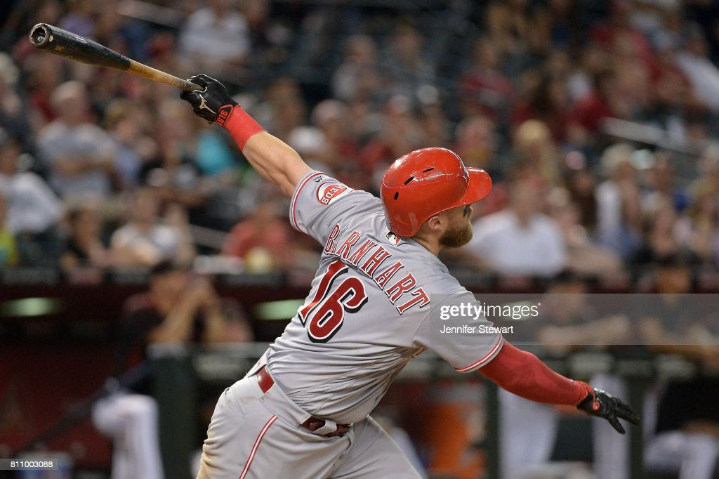 Tucker Barnhart #16 of the Cincinnati Reds hits a solo home run during the ninth inning of the MLB game against the Arizona Diamondbacks at Chase Field on July 8, 2017 in Phoenix, Arizona. The Cincinnati Reds won 7-0.