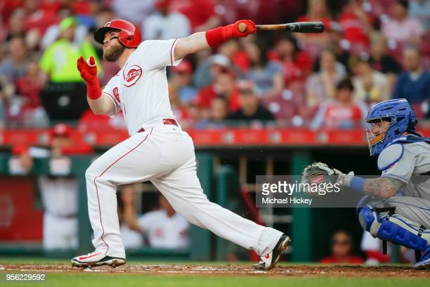 Tucker Barnhart of the Cincinnati Reds hits a triple in the second inning against the New York Mets at Great American Ball Park on May 8 2018 in...