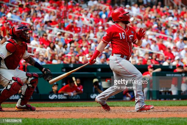 Tucker Barnhart of the Cincinnati Reds hits a twoRBI double against the St Louis Cardinals in the eighth inning during game one of a doubleheader at...