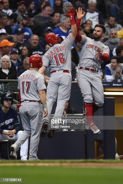 Tucker Barnhart of the Cincinnati Reds is congratulated by Jesse Winker following a three run home run during the second inning against the Milwaukee...