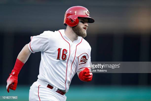 Tucker Barnhart of the Cincinnati Reds rounds the bases after hitting a solo home run in the second inning against the Cleveland Indians at Great...