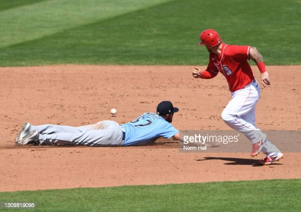 Tucker Barnhart of the Cincinnati Reds rounds the bases on his way to scoring on a ball that gets by Jantzen Witte of the Seattle Mariners for a...