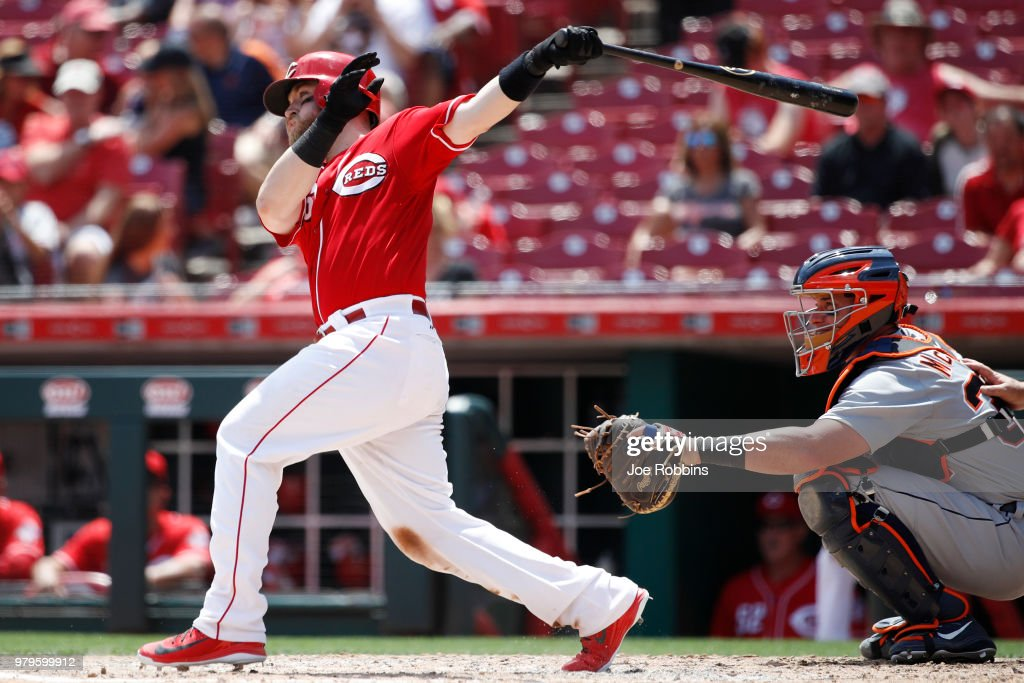 Tucker Barnhart #16 of the Cincinnati Reds singles to center field to drive in a run in the seventh inning against the Detroit Tigers at Great American Ball Park on June 20, 2018 in Cincinnati, Ohio. The Reds won 5-3.