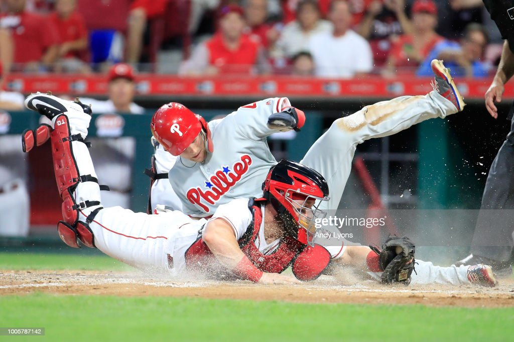 Tucker Barnhart #16 of the Cincinnati Reds tags out Scott Kingery #4 of the Philadelphia Phillies at home plate in the fifth inning at Great American Ball Park on July 26, 2018 in Cincinnati, Ohio.