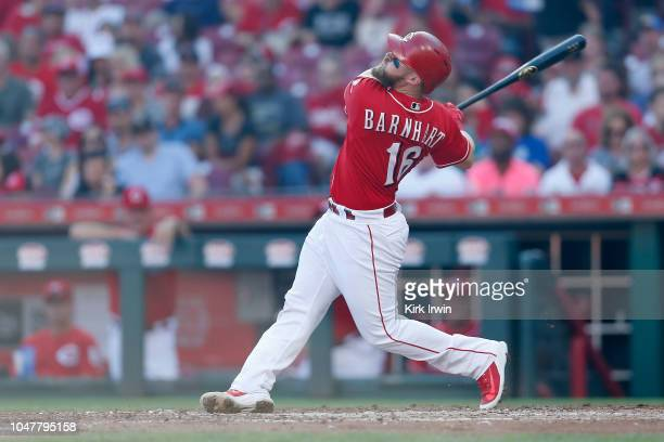 Tucker Barnhart of the Cincinnati Reds takes an at bat during the game against the Pittsburgh Pirates at Great American Ball Park on September 29...