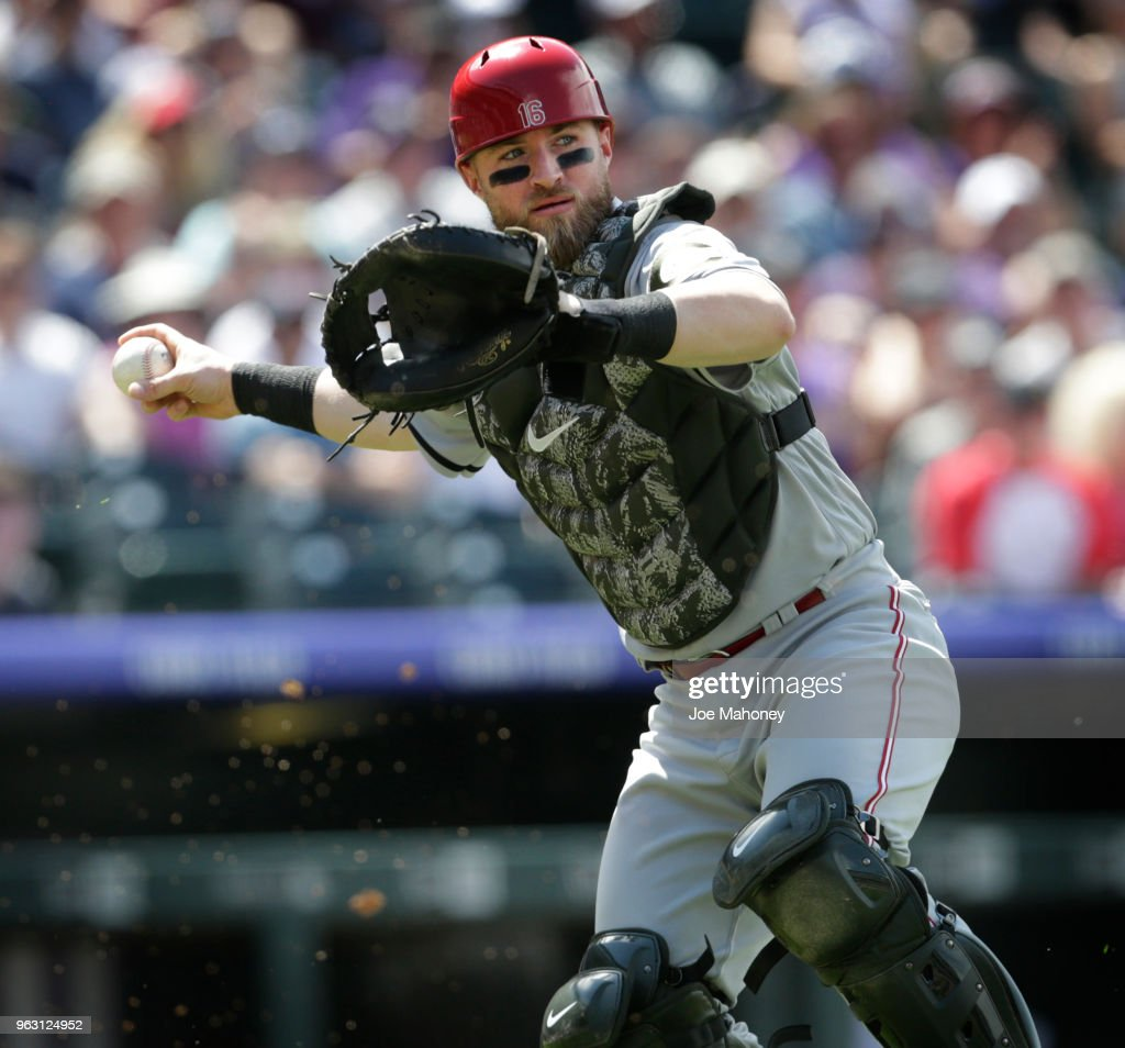 Tucker Barnhart #16 of the Cincinnati Reds throws to first base to put out German Marquez #48 of the Colorado Rockies on an attempted bunt in the sixth inning at Coors Field on May 27, 2018 in Denver, Colorado.