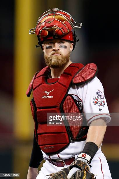 Tucker Barnhart of the Cincinnati Reds walks back to home plate during the game against the Pittsburgh Pirates at Great American Ball Park on...