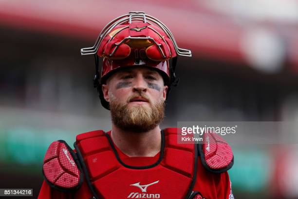 Tucker Barnhart of the Cincinnati Reds walks back to the dugout during the game against the Pittsburgh Pirates at Great American Ball Park on...