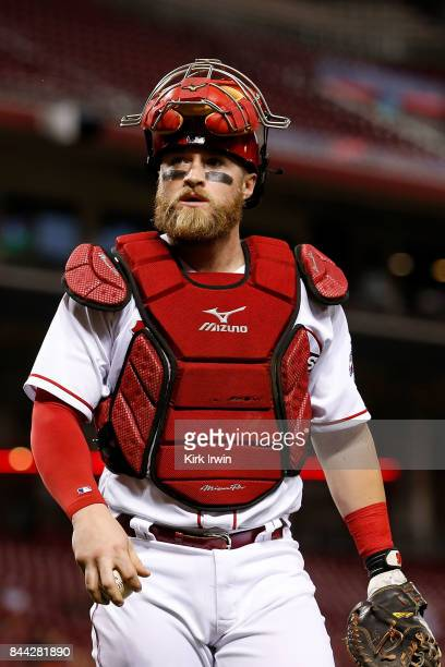 Tucker Barnhart of the Cincinnati Reds walks off of the field at the end of an inning during the game against the Milwaukee Brewers at Great American...