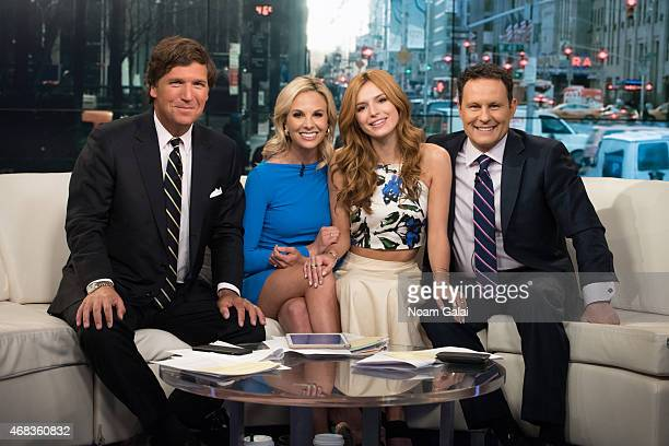 Tucker Carlson Elisabeth Hasselbeck actress Bella Thorne and Brian Kilmeade pose onstage during 'Fox Friends' at FOX Studios on April 2 2015 in New...
