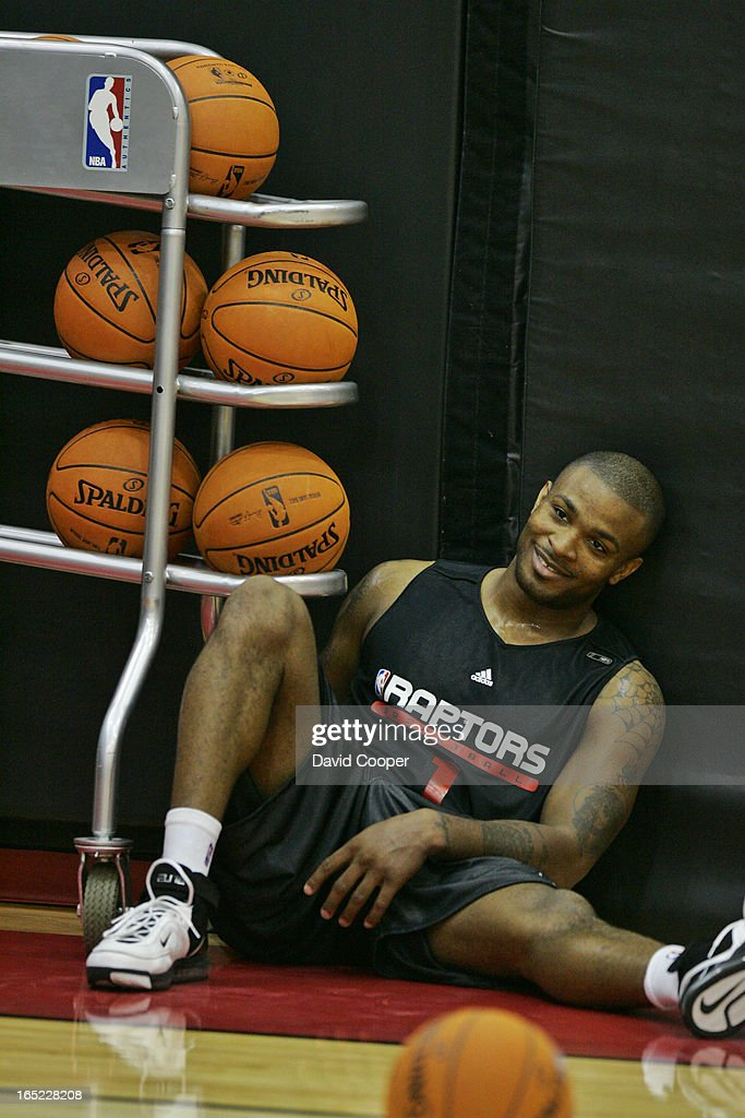 P.J. Tucker crashes backwards into the basketball rack during Raptors practice in the Flight Deck at : News Photo