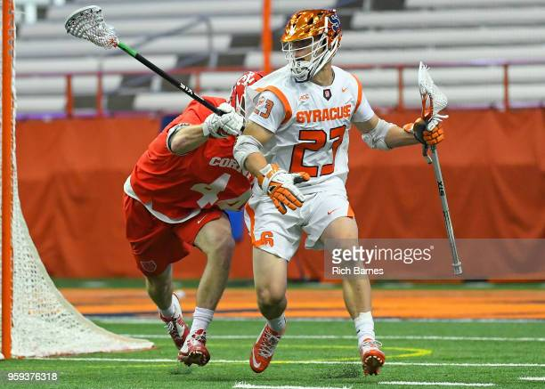 Tucker Dordevic of the Syracuse Orange dodges to the goal past Scott Flynn of the Cornell Big Red during a 2018 NCAA Division I Men's Lacrosse...