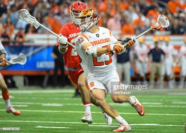 Tucker Dordevic of the Syracuse Orange shoots the ball in front of Ryan Bray of the Cornell Big Red during a 2018 NCAA Division I Men's Lacrosse...
