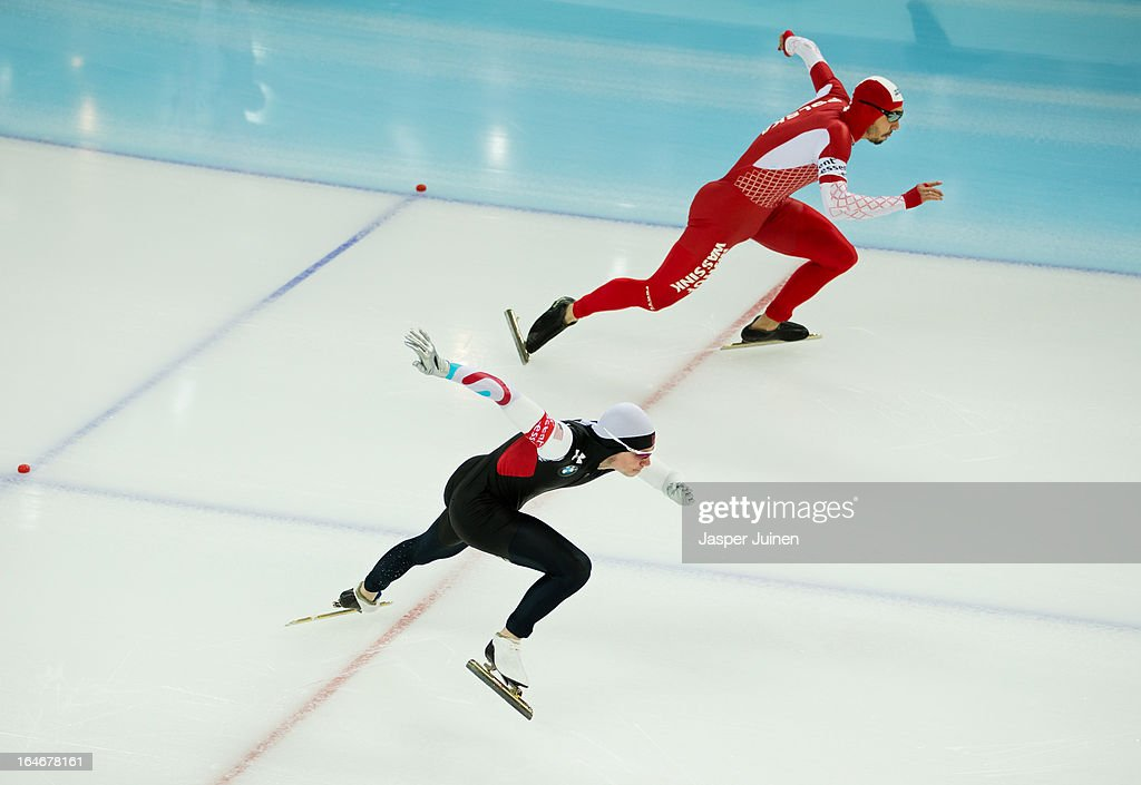 Tucker Fredricks (R) of the US competes against Artur Was of Poland during the 500m race on day four of the Essent ISU World Single Distances Speed Skating Championships at the Adler Arena Skating Center on March 24, 2013 in Sochi, Russia.