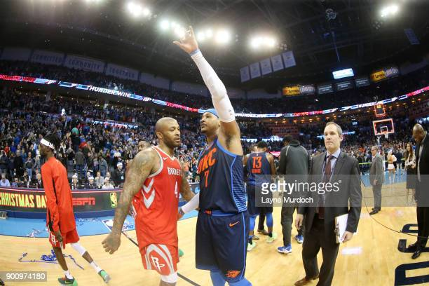 Tucker of the Houston Rockets and Carmelo Anthony of the Oklahoma City Thunder exchange a hug after the game between the two teams on December 25...