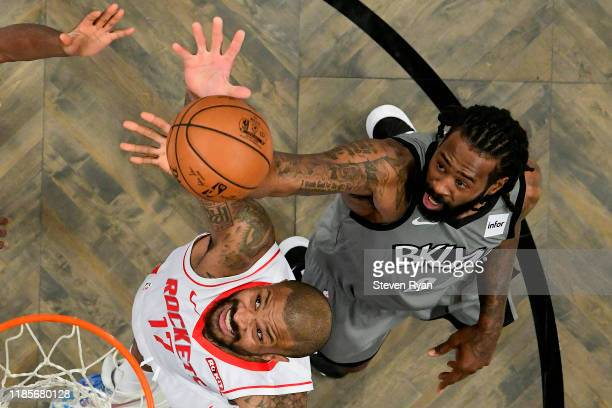 Tucker of the Houston Rockets and DeAndre Jordan of the Brooklyn Nets battle for the ball at Barclays Center on November 01 2019 in New York City...