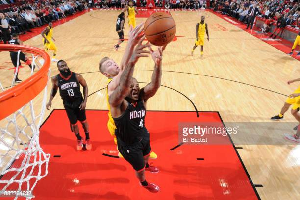 Tucker of the Houston Rockets and Domantas Sabonis of the Indiana Pacers battle for the rebound on November 29 2017 at the Toyota Center in Houston...
