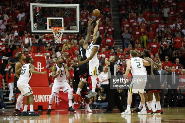 Tucker of the Houston Rockets and Donovan Mitchell of the Utah Jazz goes up or a jump ball in the second half during Game Two of the Western...