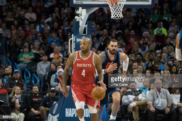 Tucker of the Houston Rockets brings the ball up court as Steven Adams of the Oklahoma City Thunder applies pressure during the second half of a NBA...