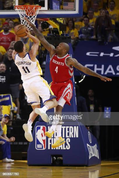 Tucker of the Houston Rockets defends a shot by Klay Thompson of the Golden State Warriors during Game Three of the Western Conference Finals of the...