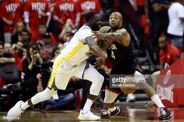 Tucker of the Houston Rockets defends Draymond Green of the Golden State Warriors during the first quarter in Game One of the Western Conference...