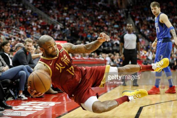 Tucker of the Houston Rockets dives for a loose ball in the second half against the Dallas Mavericks at Toyota Center on February 11 2019 in Houston...