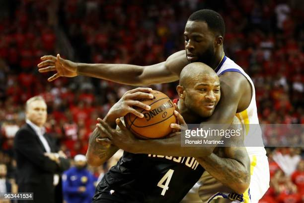 Tucker of the Houston Rockets drives against Draymond Green of the Golden State Warriors in the fourth quarter of Game Seven of the Western...