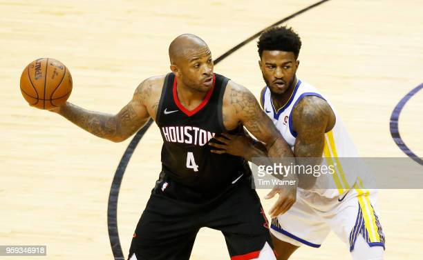 Tucker of the Houston Rockets drives against the Golden State Warriors in the second half of Game Two of the Western Conference Finals of the 2018...