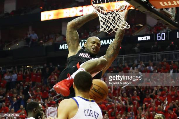 Tucker of the Houston Rockets dunks against the Golden State Warriors in the first half of Game Two of the Western Conference Finals of the 2018 NBA...