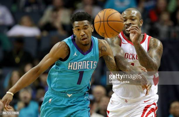 Tucker of the Houston Rockets goes after a loose ball against Malik Monk of the Charlotte Hornets during their game at Spectrum Center on October 27,...